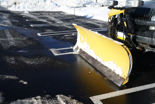 Boone NC Snow Removal, snow plow in parking lot